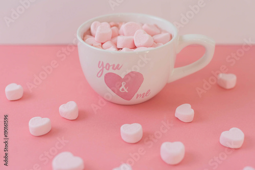 Fotobehang Chocolade Hot cocoa in a heart mug with pink heart shaped marshmallows