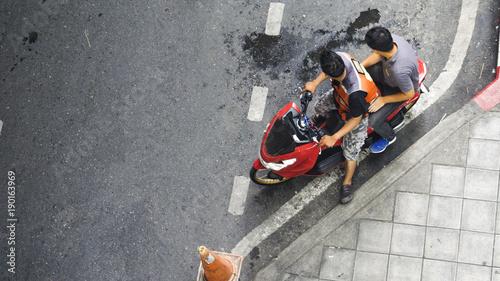 Fotobehang Fiets top view of biker and people sit on the motorcycle
