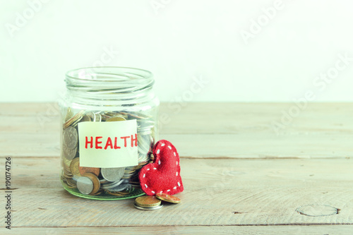 Coins in jar with Health label