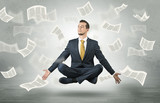 Businessman meditating with flying paper concept - 190180116