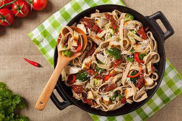 Whole-grain tagliatelle pasta with grilled chicken.