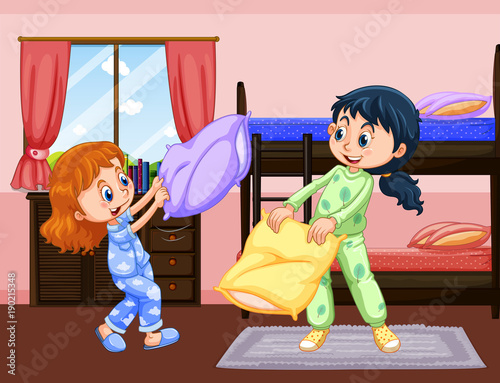 Fotobehang Kids Two girls playing pillow fight in bedroom