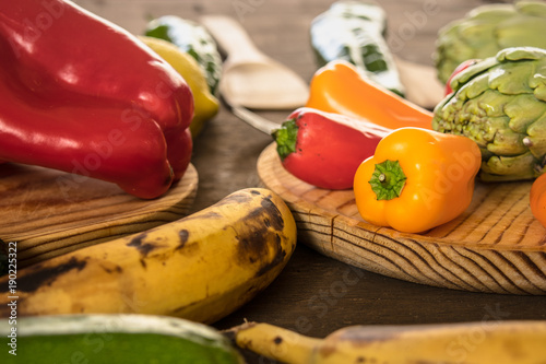 Fruits and vegetables on a rustic table:lemons, zucchini,peppers, bananas, asparagus.Healthy food