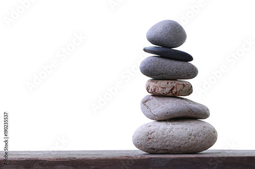 Foto op Canvas Spa Balance Stones stacked placed on a wooden floor.