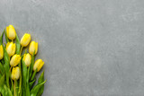 Fototapeta Tulipany - Yellow tulips, spring easter background or anniversary gift for mothers day or card for women's day at 8 march © alicja neumiler