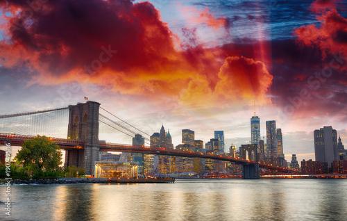 Manhattan skyline and Brooklyn Bridge view from Brooklyn Bridge Park at sunset, New York City