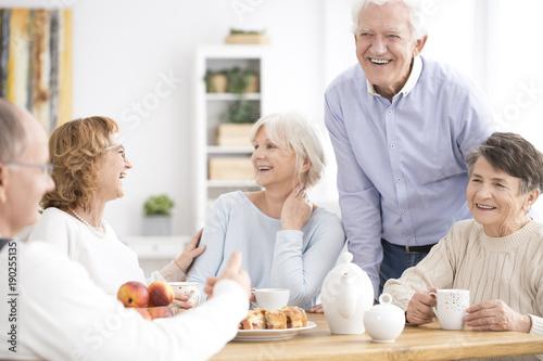 Smiling senior people enjoying meeting