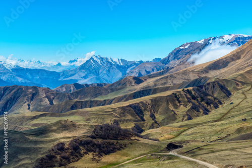 Fotobehang Blauw amazing view of spring day landscape Caucasus mountains with blue sky Russia, Republic Ingushetia