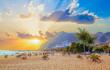 Leinwanddruck Bild - Beautiful summer scene on Teresitas beach with people enjoying holiday in sunset light, in Tenerife, Canary island of Spain
