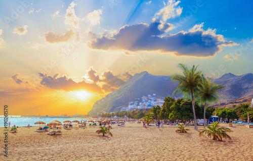 Leinwanddruck Bild Beautiful summer scene on Teresitas beach with people enjoying holiday in sunset light, in Tenerife, Canary island of Spain