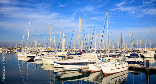 Foto op Canvas Cyprus Marina at Larnaca hosts moored boats, Cyprus. Reflection of boats, blue sky with clouds background.