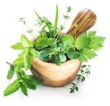 Different fresh green herbs in the wooden mortar. - 190278709
