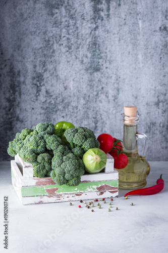 Green vegetables, broccoli, gray background