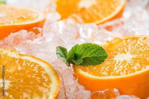 Orange slices in ice, macro.