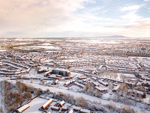 Foto op Plexiglas Parijs Aerial view of snow covered traditional housing suburbs in England. Snow, ice and adverse weather conditions bring things to a stand still in the housing estates of a British suburb