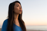 Young Asian woman looking at sunset sky - 190317323