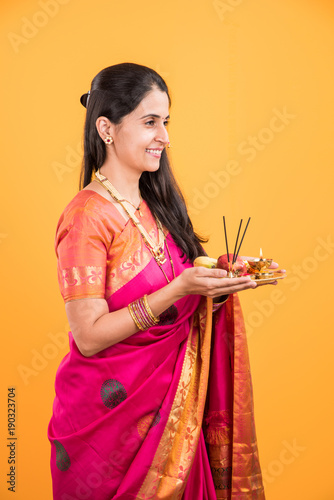 Indian Woman Performing Puja Indian Girl With Pooja Thali Or Puja Thali Portrait Of
