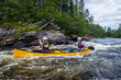 Group of people paddling the whitewater of the Noire River in Quebec, Canada.