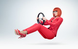 Young business woman in red and glasses driver car with a wheel, auto lady concept. - 190328151