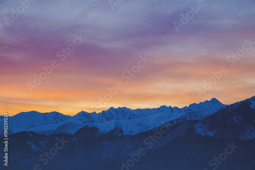 Foto op Plexiglas Ochtendgloren Sunrise over snow Tatry mountains in winter time.