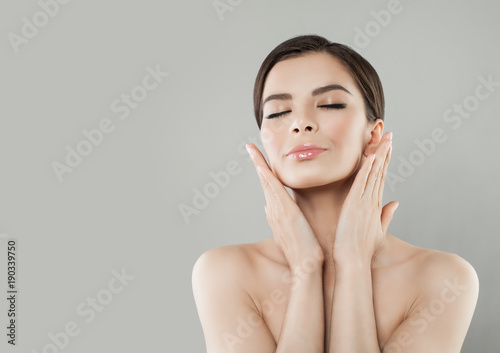 Spa Portrait of Beautiful Woman with Healthy Skin. Nice Model on Background