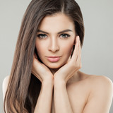 Young beautiful woman face close up portrait with healthy skin and hair