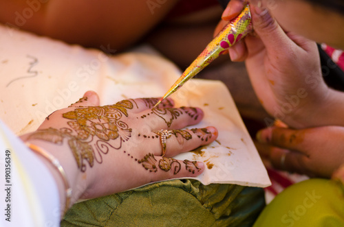 applying henna on hand, Hindu wedding ,Rajasthan, India
