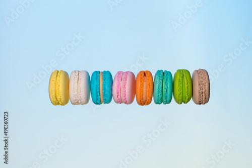 Fotobehang Macarons Colorful macarons cakes. Sweet french macaroons flying in motion.