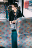 Hip young woman daydreaming on the train - 190363555
