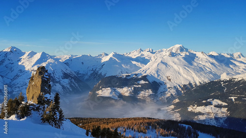 view on a cloudy  valley in snowy mountain on bleu sky