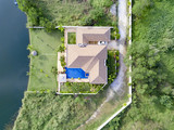 Top View Beautiful Garden Villa Resort, Above the Holiday Villa with swimming Pool on the lake with green garden. Aerial Drone Top View Top View Village scenic Landscape. - 190384983