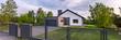 Leinwandbild Motiv House with fence and garage