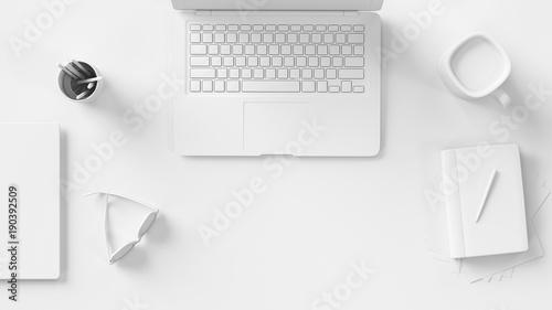 Schreibtisch in weiß mit Computer von oben