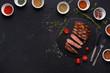 Quadro Rib eye steak and spices on black background