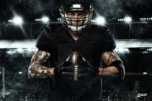 Fotobehang Voetbal Sport concept. American football sportsman player holding ball on stadium.