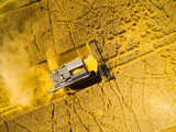 Aerial view of combine harvester on wheat field. Agriculture and biofuel production theme.  - 190446145