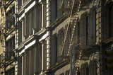 Close-up of fire escapes running down the facades of iconic cast iron buildings in Soho, New York City - 190452151