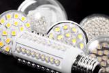 Newest LED light bulb on black background - 190455338