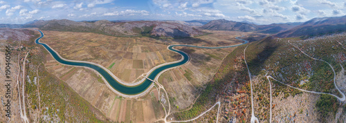 Fotobehang Bergrivier Panoramic aerial view to the valley and the Trebishnica river in the Bosnia and Hercegovina mountains.