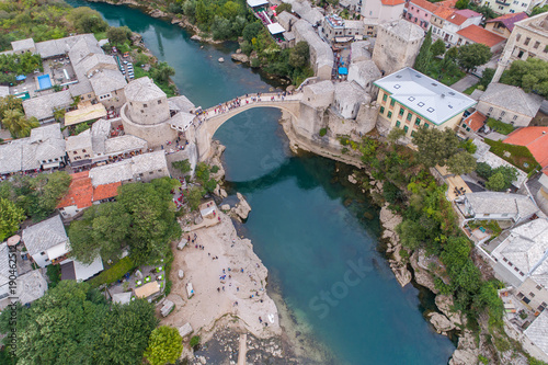 Fotobehang Groen blauw Aerial view on the city Mostar and Old Bridge. Bosnia and Hercegovina.