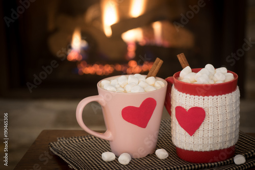 Canvas Chocolade Romantic Valentine's Day, Warm Fireplace Scene with Red and Pink Cocoa Mugs with red Hearts in Cozy Living room with space for copy, text, or your words or Design. Horizontal natural lighting