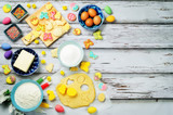 Wood background with Sugar Easter cookies and ingredients for baking - 190487360