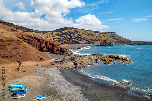 Fotobehang Blauw Ocean and volcanic shores near the tiny seaside village of El Golfo, close to the Green Lagoon (Charco de Los Clicos). Lanzarote island, Canaries, Spain.