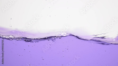 violet water waves and splashes in 180fps slow motion