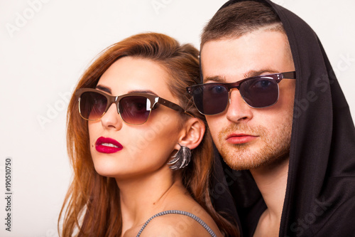 beautiful fashion couple with sunglasses on a white background. Vogue Style © Rock and Wasp