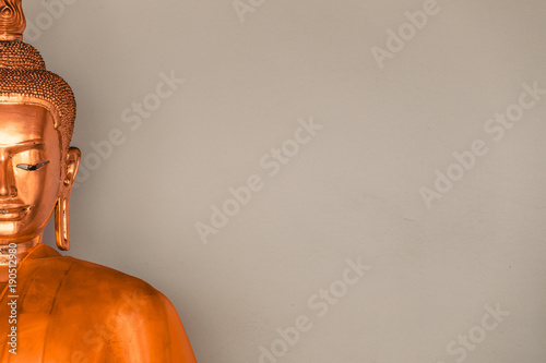 Foto op Canvas Boeddha buddha face with empty wall for editing text behind