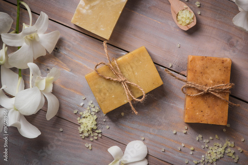 Spa setting with orchid, spoon,towel, soap, salt stones on old wooden background