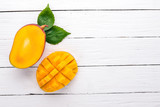 Mango. Tropical Fruits. On a wooden background. Top view. Copy space.