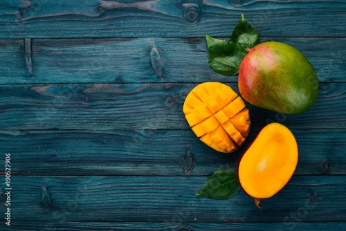 Mango. Tropical Fruits. On a wooden background. Top view. Copy space. - 190527906