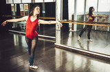 Woman in ballet pose in studio - 190530100